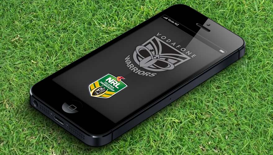 Smartphone with Warriors application on grass