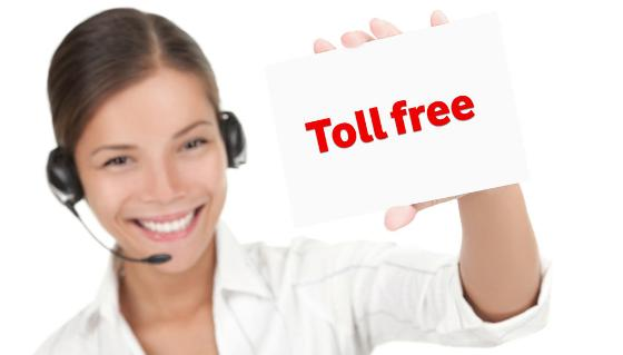 Customer Service Representative With Headset Holding a Sign Says Toll Free