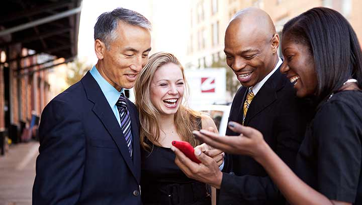 Business People Looking At Mobile Phone