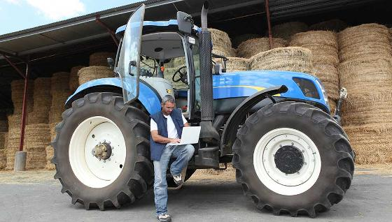 Farmer accessing broadband on his laptop