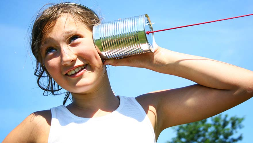 Girl listening to tin can phone