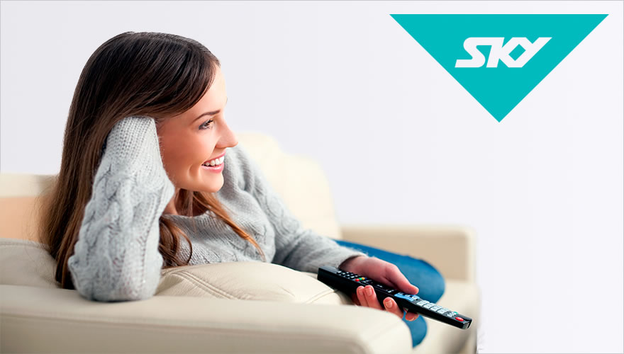 Woman watching TV with Sky Logo