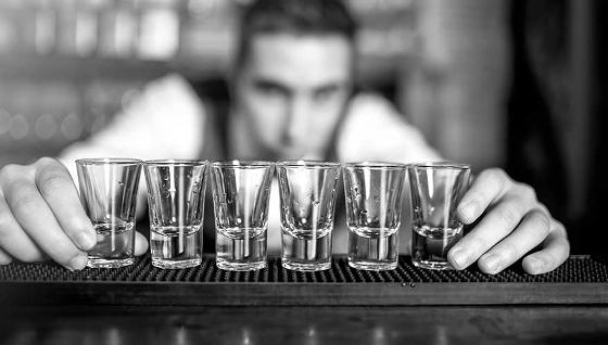 Barman with shot glasses